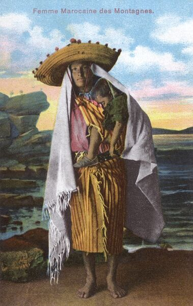Tangiers - Morocco - A Woman of the Mountains carrying her sleeping child in a sling across her shoulders and wearing a wide-brimmed straw hat and very large scarf/shawl. Date: circa 1910s