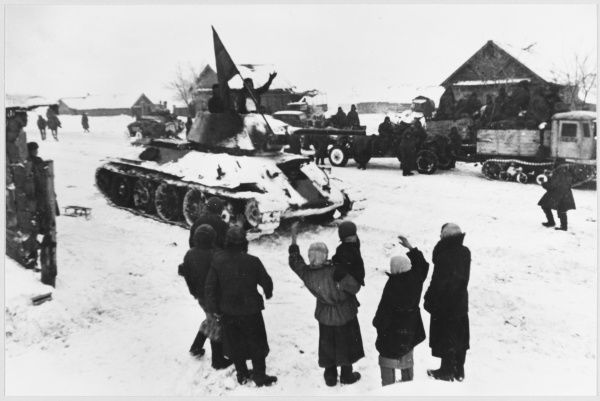 LIBERATION SCENES Liberated village in December offensive. The tank is a Russian T-34