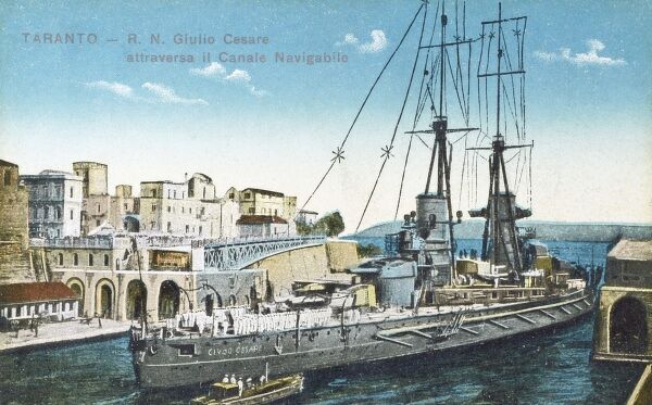 Taranto, Italy - The Italian warship R. N. Giulio Cesare pases through the famous Swing Bridge over the Canale Navigabile Date: circa 1910s