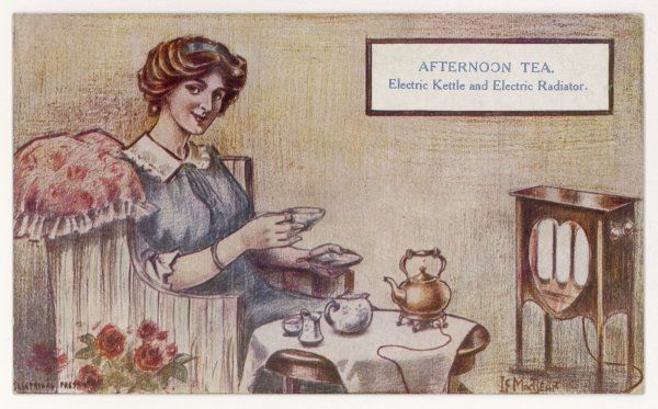 Afternoon tea in the electric home - a housewife uses her electric kettle and her electric radiator
