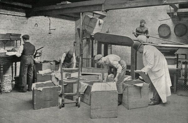 Workers with a tea merchant's cutting and mixing machine at Messrs Traver's Wharf, Bankside, London