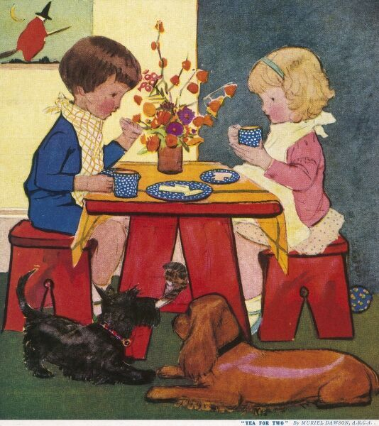 Two young children sit at a trestle table and enjoy a snack, possibly elevenses or supper