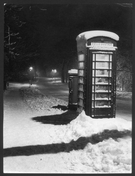 A night study after a fall of snow, showing a telephone kiosk and a (postal) pillar box, Elstree, Hertfordshire, England