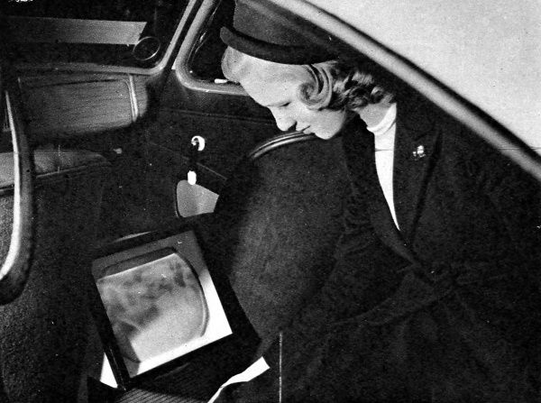 Television in a private car; an experimental installation in a standard Vanguard saloon. The screen is not visible to the driver, thus avoiding distraction. The reception is received by a whip aerial, and could be watched on country and London outskirts roads