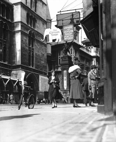 Temple Bar from the Strand, central London, showing fashionable ladies shopping near The Ceylon Shop, 'The Shop that is Different&#39