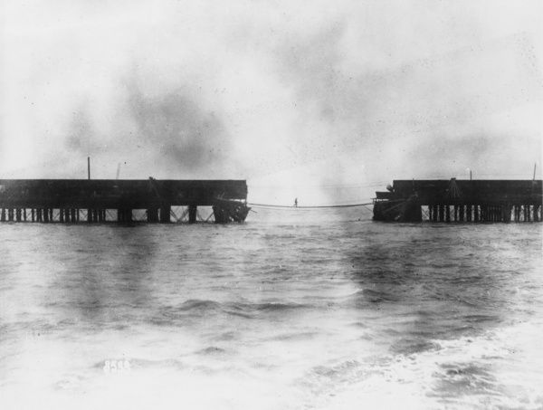 The temporary bridge across the gap in the viaduct at the landward end of the mile-long Zeebrugge Mole, at the sea port of Zeebrugge, Belgium, during the First World War