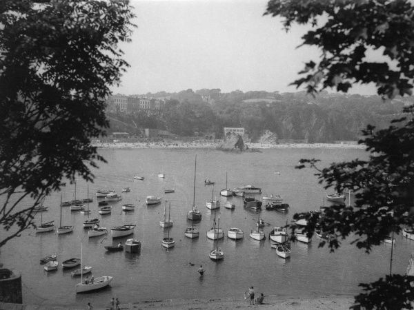 A quiet scene, with moored craft in the harbour at Tenby, Pembrokeshire, Wales. Date: 1950s