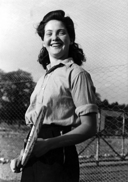 Anyone for tennis? A fashionable young woman, with her sleeves rolled up, ready for a game of tennis! Date: 1940s