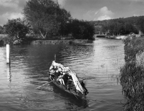 A glimpse of the River Thames at Eynsham, Oxfordshire, England. Date: 1950s
