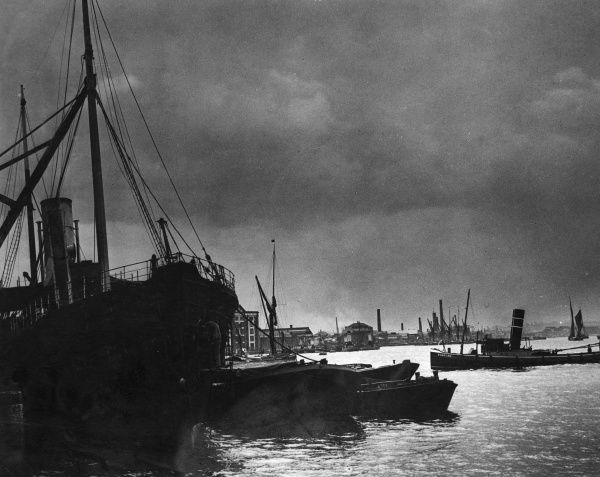 An atmospheric view of the working river and shipping. Date: 1930