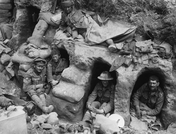 Men of the Border Regiment resting, some in funk holes, in a front line trench at Thiepval Wood during the Battle of the Somme