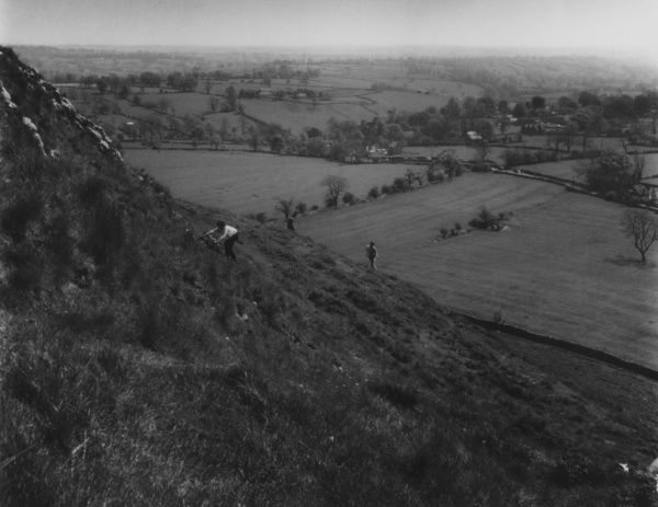 Climbers on the slopes of Thorpe Cloud (900 feet high), looking towards Thorpe Village, Derbyshire, England. Date: early 1960s