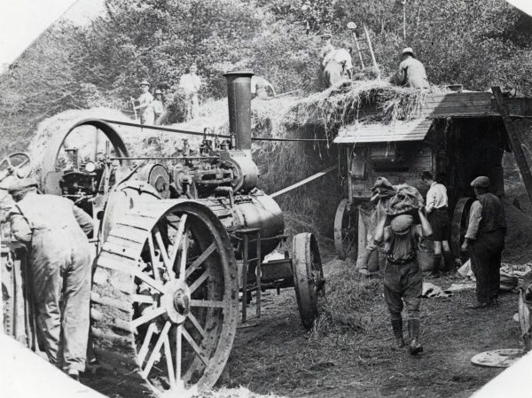 People threshing at harvest time in the parish of New Moat, Pembrokeshire, South Wales. Date: early 1920s