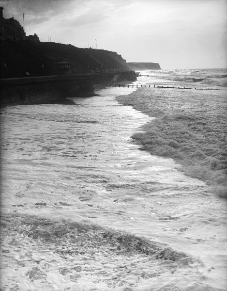 The tide rushing in during rough weather at Cromer, Norfolk, England