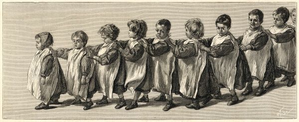 A scene showing a snaking line of small children, all holding on to one another and looking rather glum