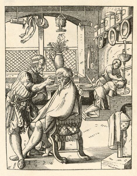 Gentleman at the barbers gets a haircut, while a chap in the background has his washed