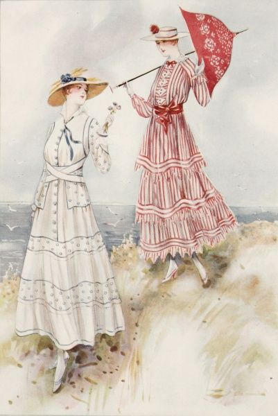 Two women wearing the latest fashions suitable for the beach. One carries a matching parasol