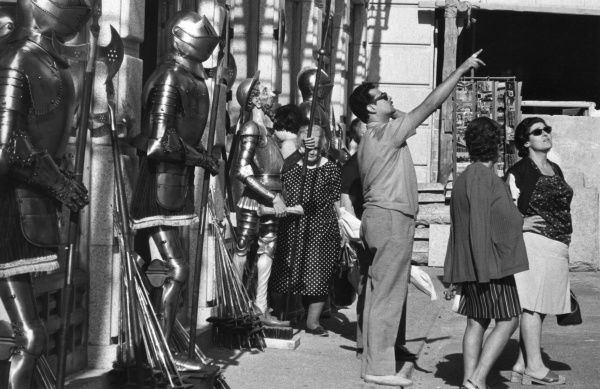 Tourists among suits of armour at Toledo, Spain. Date: 1960s