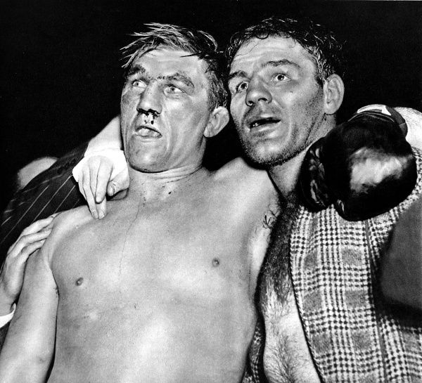 Photograph of Tommy Farr (1914-1986)(left) and Clarence 'Red' Burman, after their heavyweight boxing match, Harringay, London, 1939. Farr, known as the 'Tonypandy Terror' to his British fans, won the match on points