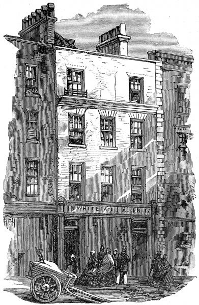 Engraving showing the exterior of Tom's Coffeehouse, Great Russell Square, Covent Garden, London, 1865