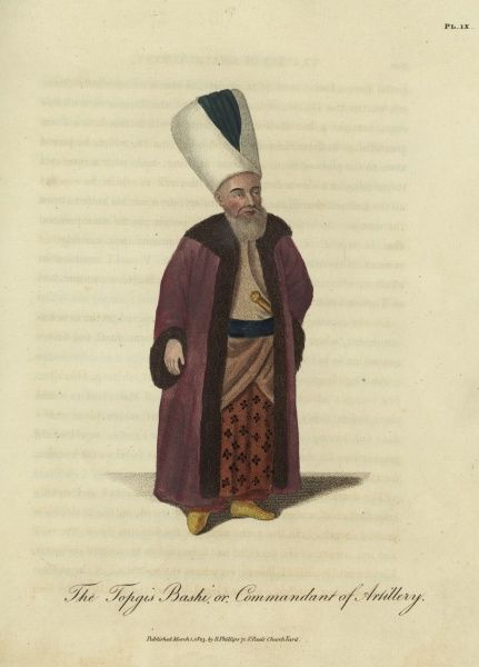 The Topgis Bashi, or Commandant of Artillery. The commander of the Turkish Ottoman artillery wearing colourful robes and a tall turban. The handle of a knife or dagger can be seen tucked into his waistband. 1803