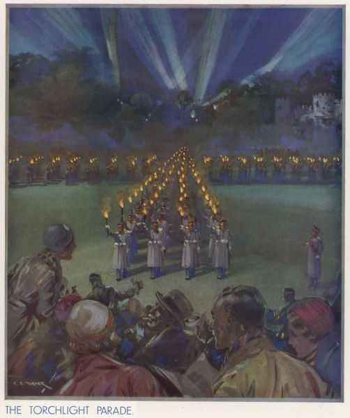 The famous Torchlight Parade revived at Aldershot Tattoo and performed by the 3rd Battalion of the Grenadier Guards, the 1st Battalion of the Irish Guards and the 2nd Battalion of the Queen's Regiment