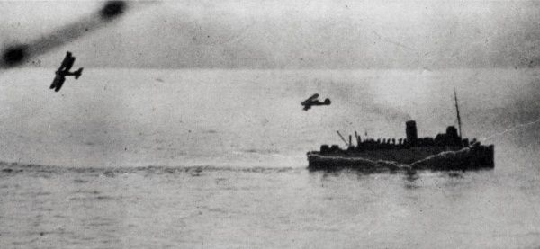 This photograph shows an aircraft making an attack on a merchant vessel