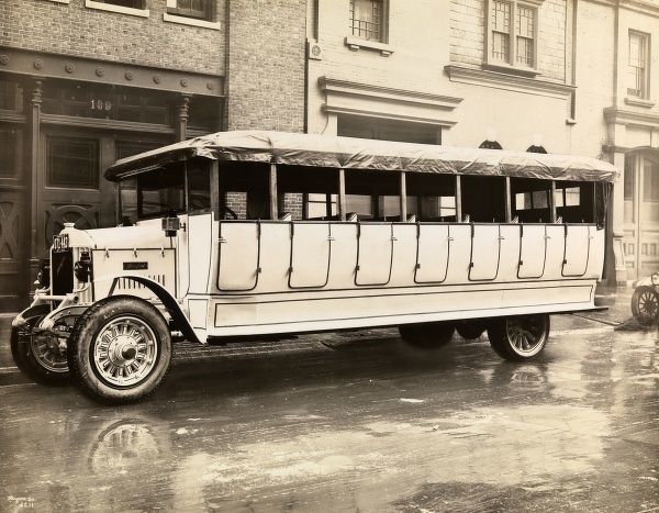 Automobile Buses. Sanford bus parked on the street; buildings beyond-1921 New York plates