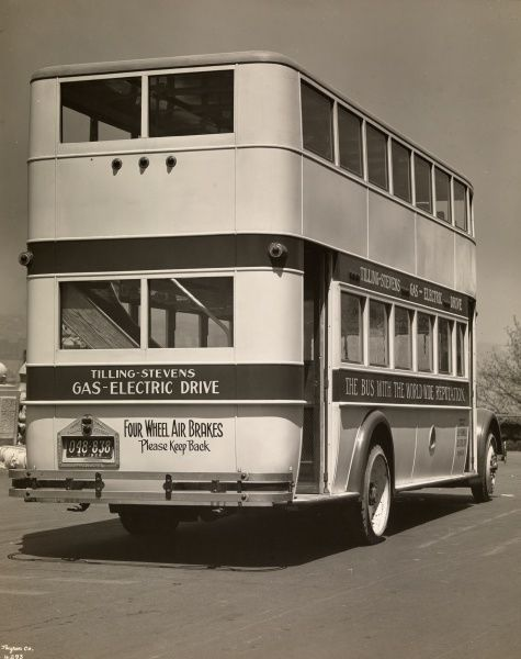 Ziehler Albert, American Bus Truck Co., Automobile, Double Deck Bus four-fifths, rear.. Double-decker bus parked on the roadside. A sign on the bus reads: Tilling