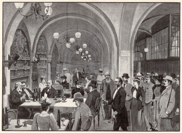A party of tourists are led to a table in a RATSKELLER (a bar/restaurant beneath the City Hall)