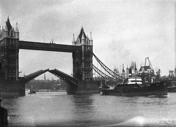 A close-up photograph of Tower Bridge, a bascule bridge and a famous London landmark, closing after a steamship has passed through it