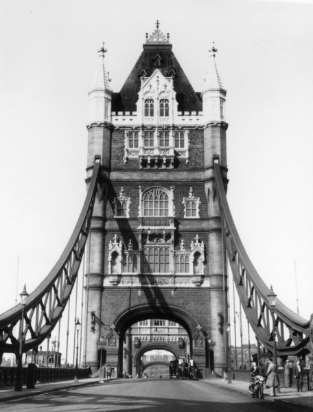 The famous Tower Bridge, a bascule bridge, London, was designed by Horace Jones, who died in 1887, before it was completed. Sir John Wolfe- Barry completed it in 1894. Date: built 1886 - 1894