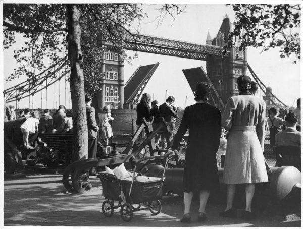 Excited children and their families watching the spectacle of the famous bascule bridge as it opens