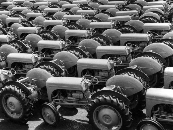 Export pattern : A consignment of brand new tractors awaiting shipment. Date: 1960s