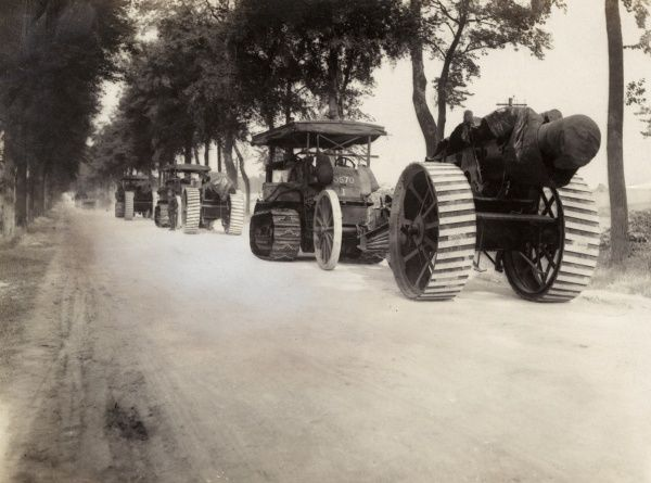 Tractors transporting heavy artillery along a country road during the First World War. Date: 1914-1918