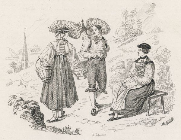 A man and two women in traditional Swiss costumes from the Unterwald canton
