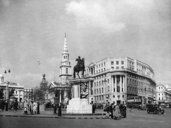 Trafalgar Square, London, showing St.-Martins-in-the- Fields church and Africa House, with the statue of King Charles I in the foreground. Date: 1950s