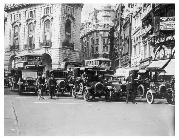Policeman directs traffic through Piccadilly Circus