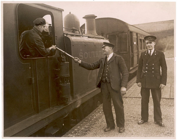 Driver and guard on the Dyke Railway, part of the Southern rail network