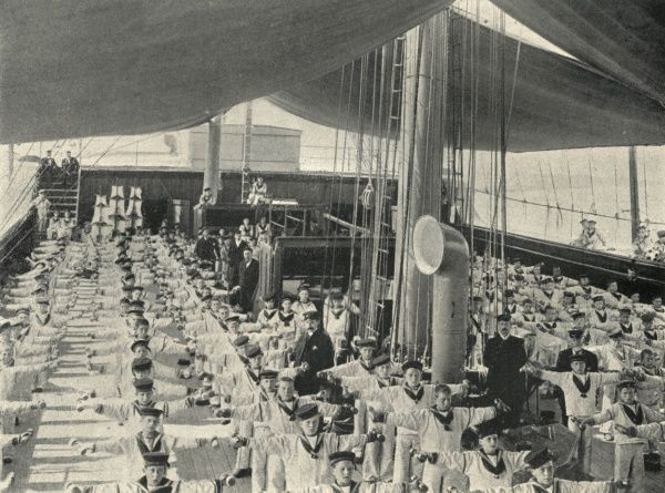 Uniformed boys on the deck of the Training Ship Exmouth perform dumb bell drill