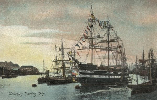 Flags fly and boys line the rigging on the Training Ship Wellesley, on the River Tyne at North Shields, Northumberland