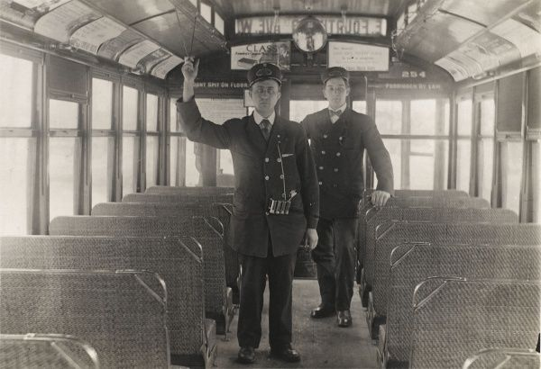 Tram conductors in car 254 running from East Fourth and 6th Avenue West, New York City, America