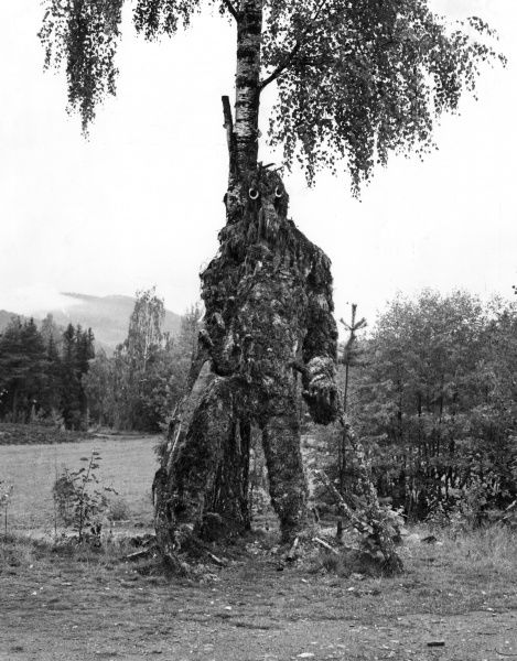 A troll, made out of tree branches and grass, Norway. Date: late 1960s