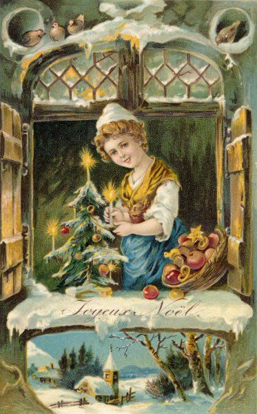A girl puts her little Christmas tree on the window sill