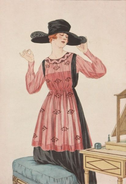 Autumn fashions featuring a pink and black dress, and a wide-brimmed hat which the wearer admires in a mirror