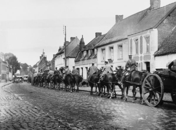 British troops and transport marching through Vieux Berquin on the Western Front in France during World War I in 1915