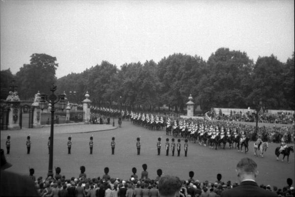 The sovereign's escort mounted by the Household Cavalry, Blues and Royals, leave the Mall and pass by The Queen Victoria Memorial Date: 1953