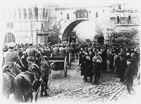 Red Army forces pass through the streets of Moscow, watched by the populace