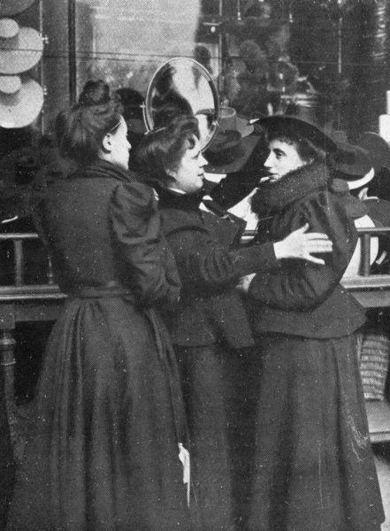 Trying on a hat at Au Printemps, Paris Date: 1905