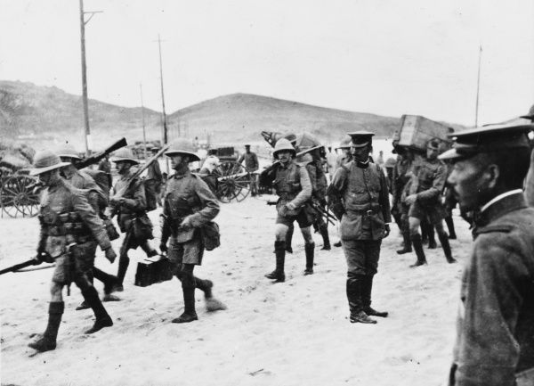 British and Japanese soldiers mingle on the beach in the Tsing-Tao area, following the joint operation to land forces with the aim of capturing the German base on the Chinese mainland